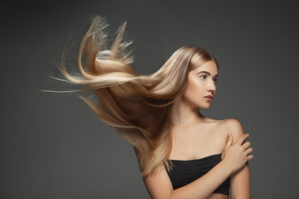 beautiful-model-with-long-smooth-flying-blonde-hair-isolated-dark-grey-studio-background-young-caucasian-model-with-well-kept-skin-hair-blowing-air-1024x683 Как ускорить рост волос? Полезные советы